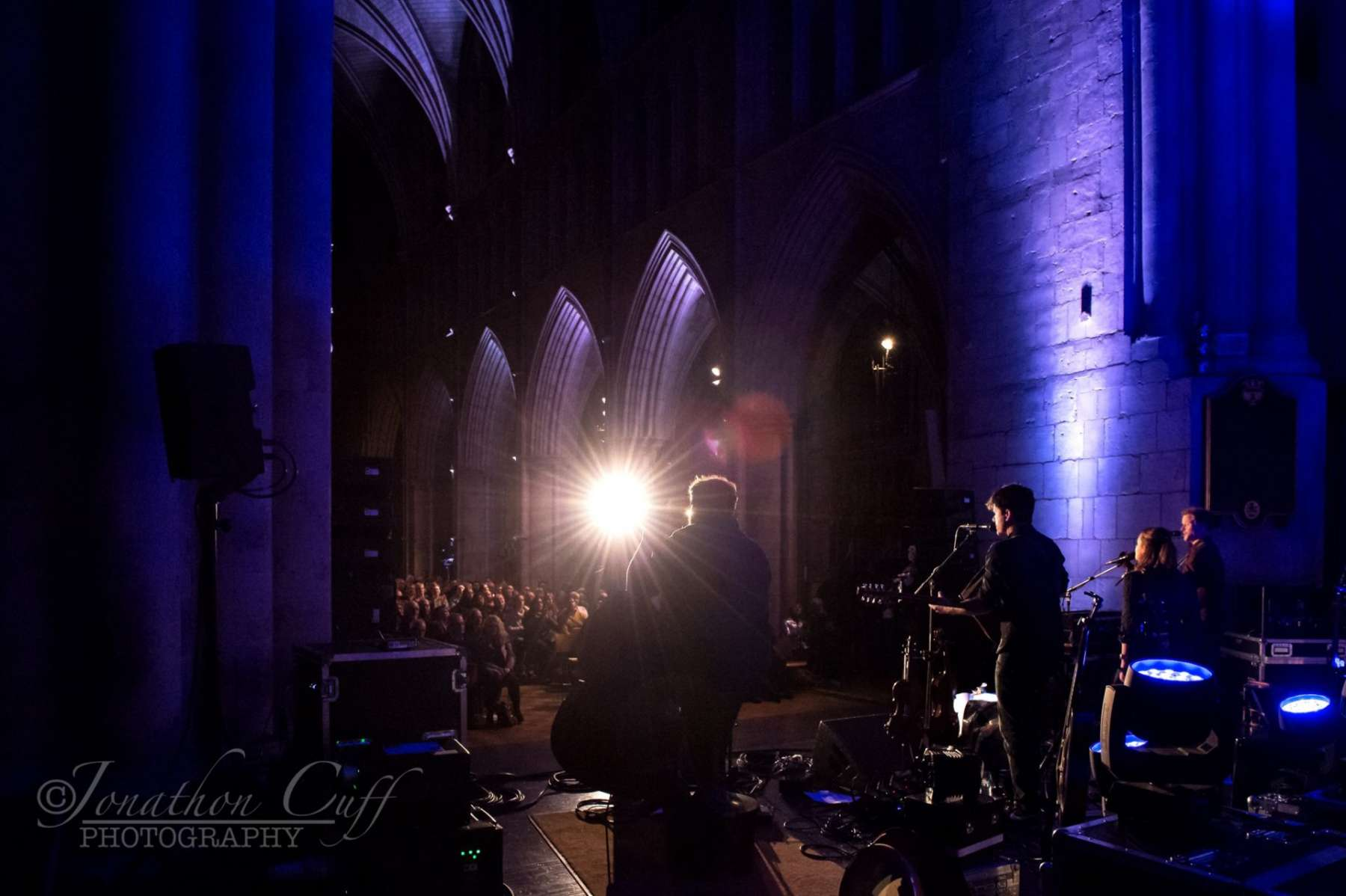 Stage view of Seth Lakeman live in a cathedral